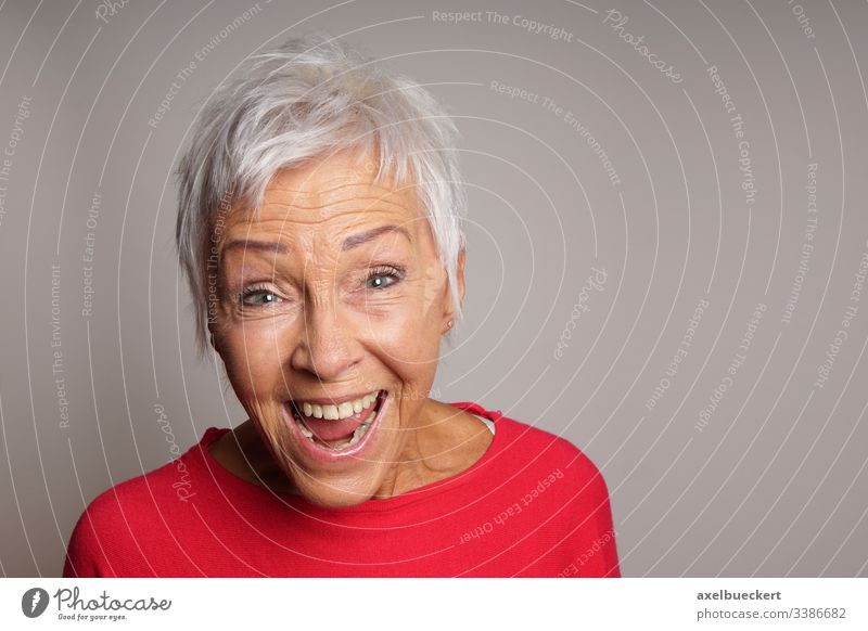 laughing senior woman mature lady happy happiness adult best ager 60 white hair older female people elderly short grey gray portrait caucasian modern sixties