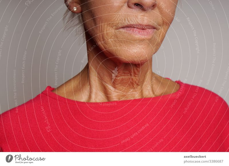 old woman's neck with wrinkles aging wrinkled skin face throat chin mouth mature age senior lady beauty dermatology adult older female people elderly person