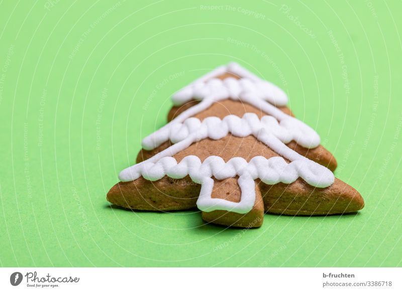Gingerbread tree on green background gingerbread sugar icing glaze candy biscuits Green delicious Sweet Lie Figure Baking Christmas symbol fir tree