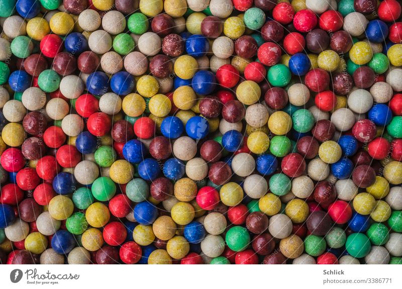 Background of colorful old clay marbles Background picture Marbles Many variegated Old vintage Clay Marbles Tone Red Blue Yellow Green Brown Black White Violet