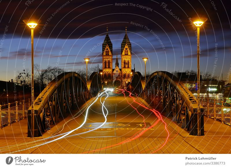bicycle bridge Freiburg im Breisgau Herz Jesu Chruch Symmetry City trips Sightseeing vacation travel Germany Europe Baden-Wuerttemberg light traces Night shot