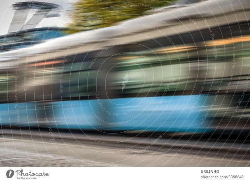 moving tram Motion blur Driving travelling suburban railway Tram Day pass Movement move Blue Gray Green swift blazing fast Dynamic