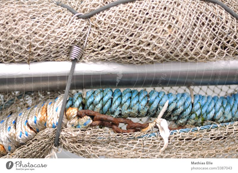 fishing net Fishing net Exterior shot Blue Day Deserted Detail String Rope Close-up Colour photo Structures and shapes Muddled Fishery Shallow depth of field