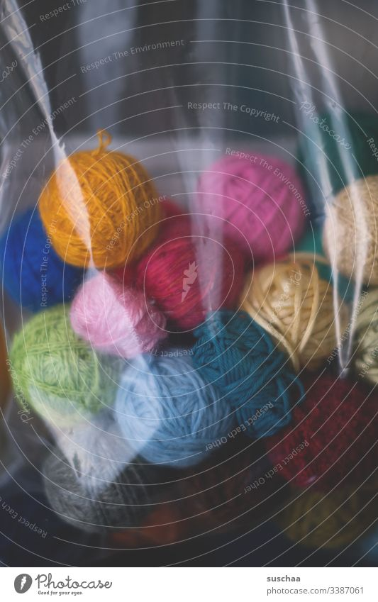 ball of wool in a plastic bag Wool Ball of wool Leisure and hobbies Soft Handcrafts Knit Calm Warmth Wooly Detail coiled variegated Plastic bag safekeeping
