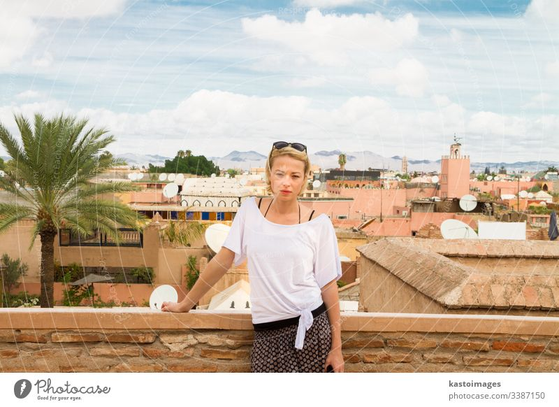 Woman admiring traditional moroccan architecture in one of the palaces in medina of Marrakesh, Morocco. morocco woman marrakesh travel tourism africa people