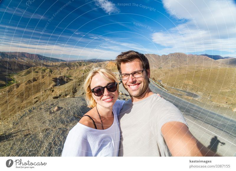 Active happy couple taking selfie on travel in high Atlas mountains, Ouarzazate, Morocco. adventure morocco portrait fun desert architecture moroccan marrakesh