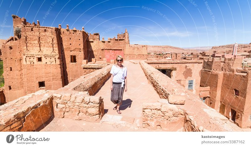 Woman on travel at Ait Benhaddou kasbah, Ouarzazate, Morocco. woman traveler backpacker adventure morocco portrait fun desert architecture moroccan marrakesh