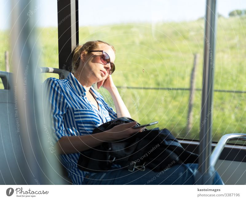 Portrait of tired woman sleeping on bus. passenger female nap commuter girl transportation inside journey people person tourism tourist beautiful work vacation