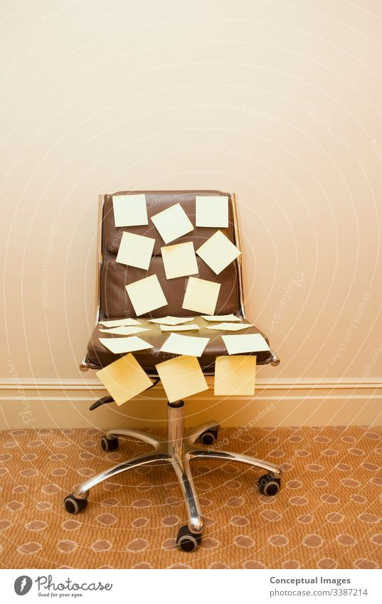 Post it notes on a chair post-it note brainstorming memo reminder to do schedule busy appointment office business paper strategy message teamwork sticky ideas