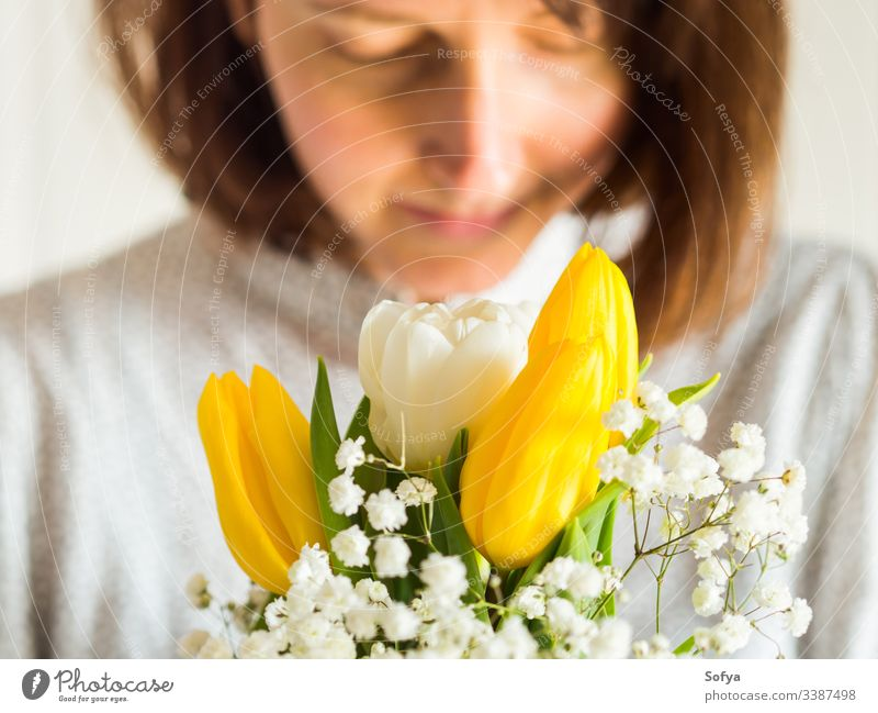Woman holding bouquet of yellow and white tulips. Women's, mother's day concept. flower bunch woman give spring easter hands floral lady march gift invitation