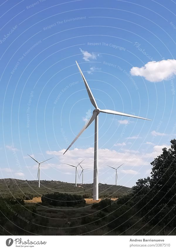 Wind generators on the mountain with blue sky industrial environment powerful conserve concept clear scenic turbine rural supply windy blades electric