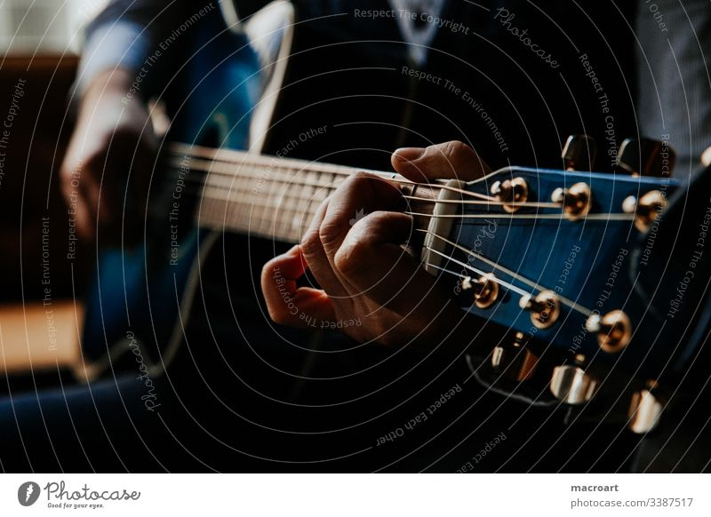 guitar Guitar Western guitar Guitarist Fretboard steel strings Blue hands Hand Man Grasp chords Close-up