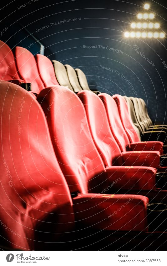 Cinema chair Movie hall Sit Seating Comfortable Film industry Movie theater seat Theatre Culture Leisure and hobbies Red Armchair Light Looking Empty