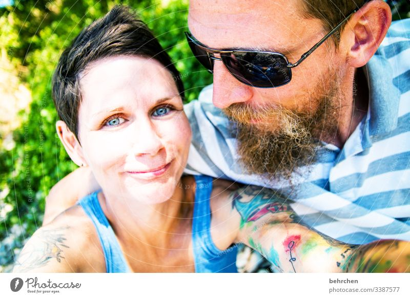 opposites | attraction portrait Blur Sunlight Contrast Light Day Tattoo Congenial Sunglasses Colour photo Exterior shot Love Together Contentment Happiness luck