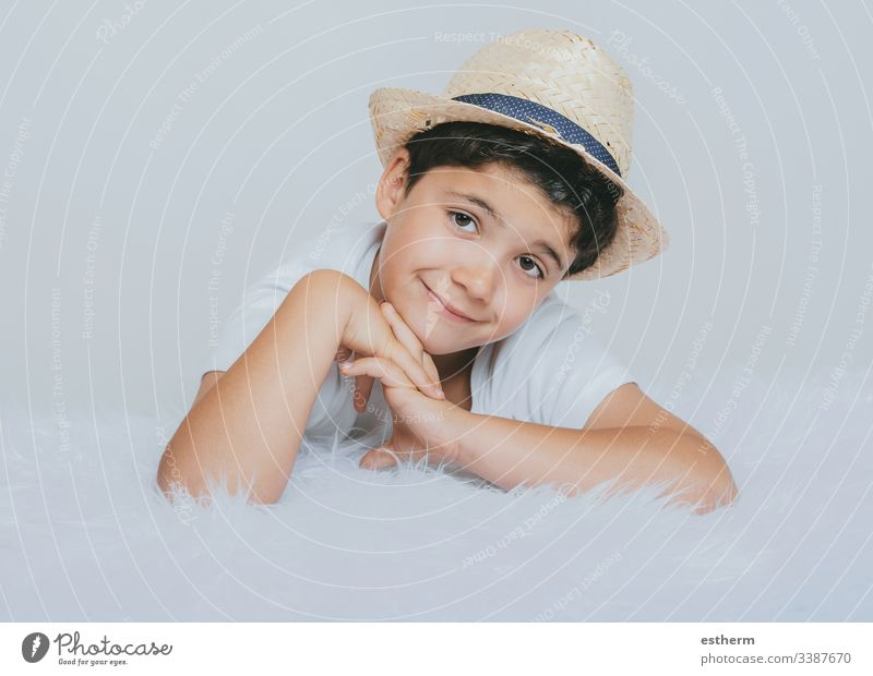 happy child smiling at camera childhood smile dreaming expression fun happiness hat portrait illusion innocence joy laugh love positivity reflection spring