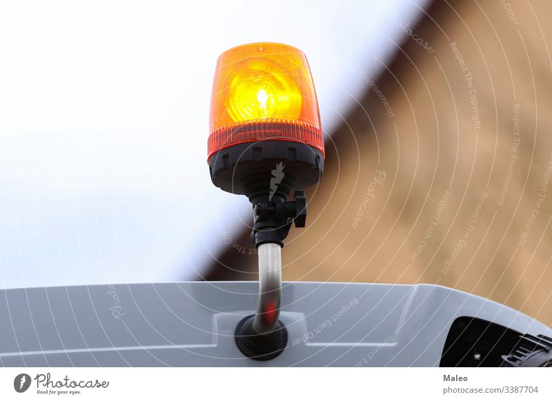 Orange flashing light on the transport on a blurred background orange abstract bright star bulb danger fire glowing illustration traffic white power decoration