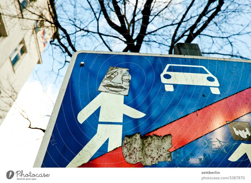 Modified traffic sign, play street on the outside Berlin Supplement grimace Face illustartion Deserted Schöneberg Play street Town Copy Space urban alienation