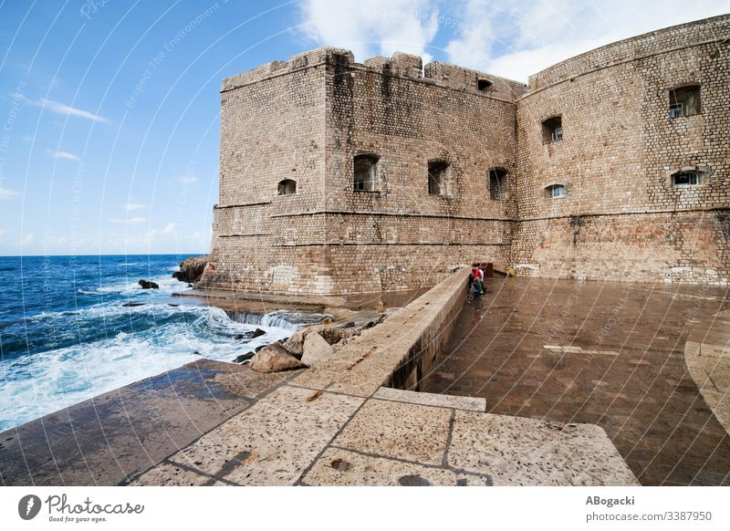 Dubrovnik Old Town Fortification And Pier dubrovnik wall fortification medieval architecture bay coast adriatic sea water stone exterior landmark croatia europe