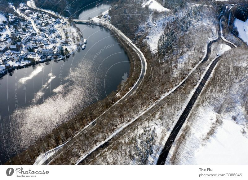 Rursee in the Eifel in winter Winter Lake Street Winding road Snow Landscape Cold Frost Tree Nature Water Lakeside Forest Subdued colour White Deserted Calm