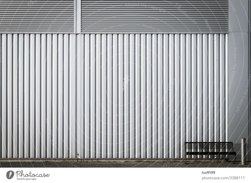 Bench with ashtray in front of a metal wall - take a seat Industrial plant Wall (building) Ashtray Metal Steel Line Sit Wall (barrier) Architecture Facade