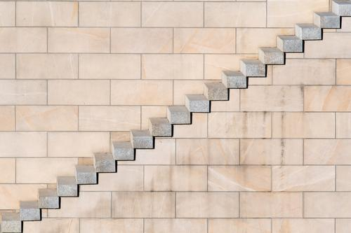 Diagonal steps with sandstone wall Wall (building) Brick Minimalistic Pecking order stagger Stairs Approach to the stairs Stone wall Arrangement lines Pattern