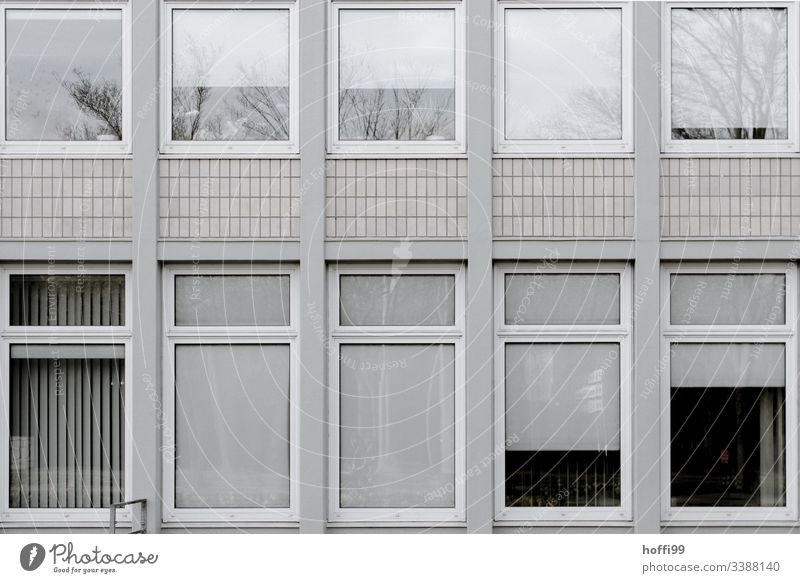 grey desolate façade Building Bad weather Facade Retro Cliche Gloomy Town Dark Venetian blinds Window Esthetic Old Roller blind Gray Modern Cold Hideous