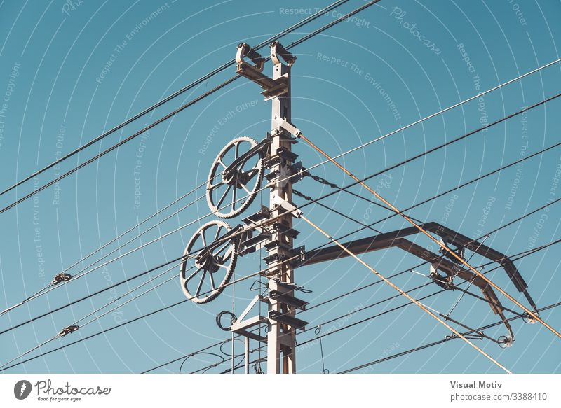 Railway catenary system and poles against clear blue sky detail transportation system railway system part railway catenary system outdoor outdoors exterior