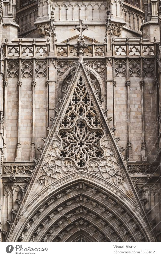 Rose window and sculpted filigrees at the front of a gothic cathedral rose window basilica architecture architectural carving sacred color outdoor outdoors