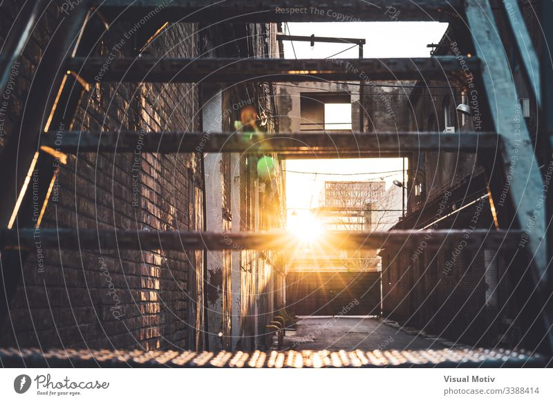 Sunbeam crossing the steps of an old factory abandoned afternoon afternoon light alley architectonic architectural architecture brick brick buildings bricks