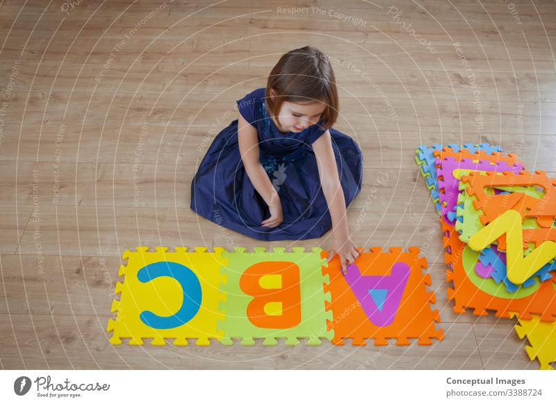 A young girl learning the alphabet abc activity bright caucasian child childhood color colorful concept copy space creative daughter development education