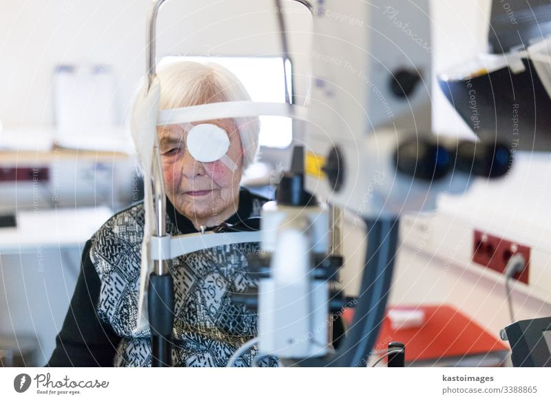 Senior woman wearing eye pathc after laser surgery procedure at ophthalmology clinic. sight senior optical vision female person beam eyepatch pensioner eld face