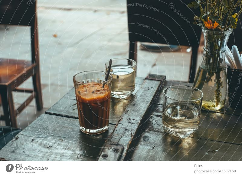 Vietnamese iced coffee on a wooden table in an outdoor café in retro colour Coffee Retro Coffee break Aromatic Morning Beverage Caffeine Vintage Brown
