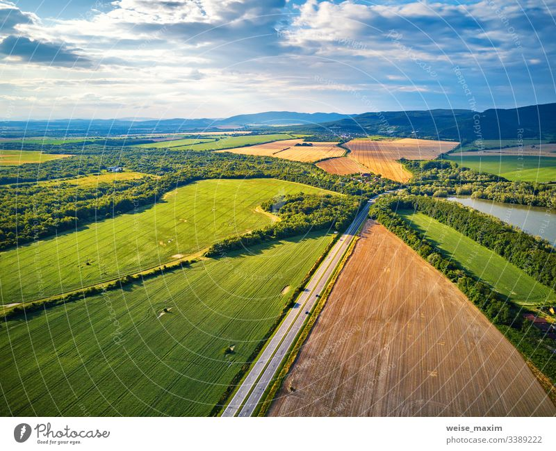 Summer landscape with fields, meadows, lake and mountains. Aerial view water summer aerial Slovakia panorama alpine Tatras park hill outdoor picturesque sunny