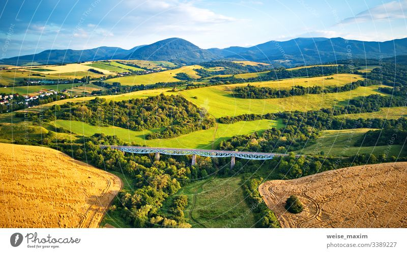 Aerial view of railway viaduct on the Tatra hills in Slovakia bridge mountain summer railroad aerial construction travel transportation panorama alpine Tatras