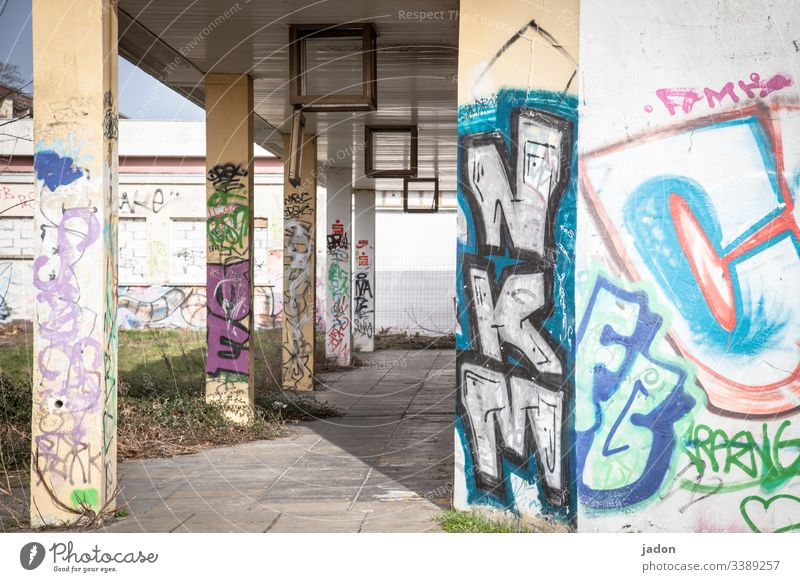 arcade with graffiti. Arcade portico Column Architecture Light Shadow Manmade structures Deserted Colour photo Day Exterior shot Building Contrast Old Facade
