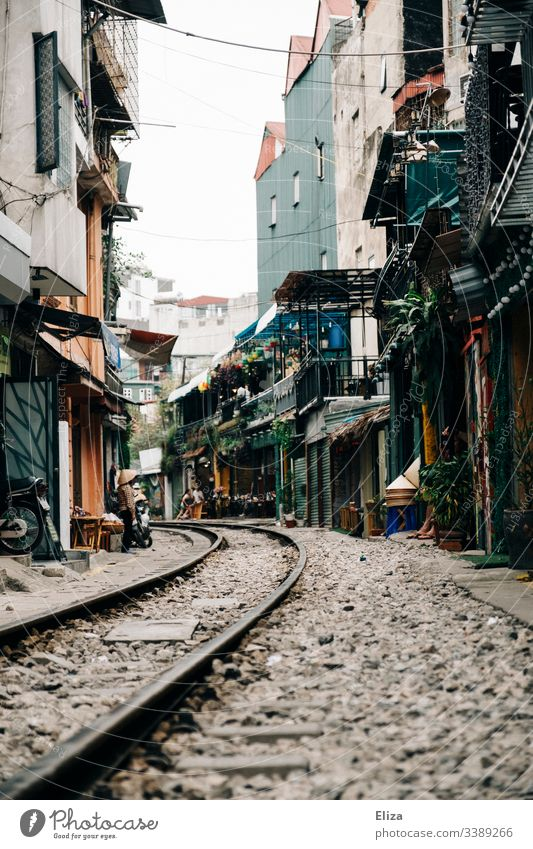 The landmark Train Street in Hanoi; train tracks that lead through a narrow alleyway, with apartment buildings and cafes Train tracks Railroad tracks Vietnam