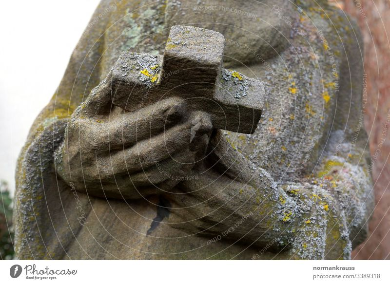 holy figure, hands holding a cross, detail Stone statue Crucifix Stone sculpture Sculpture Figure Christian Christianity Holy stop religion Religion and faith