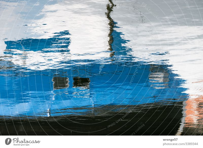 Reflection of a blue fishing boat in the water Surface of water ,Reflection Mirror image Waves Exterior shot Water Colour photo Deserted Water reflection Blue