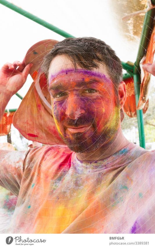 man colored in holi festival male excited crazy enjoying festival of colours men tourism concept happiness summer holy fun travel india people celebration happy