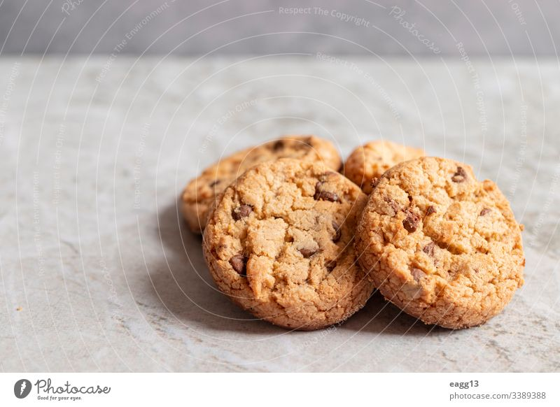 Freshly baked cookies placed on marbled texture appetizing bakery baking biscuits brown cakes calories chips chocolate close-up comfort crumbs decorations