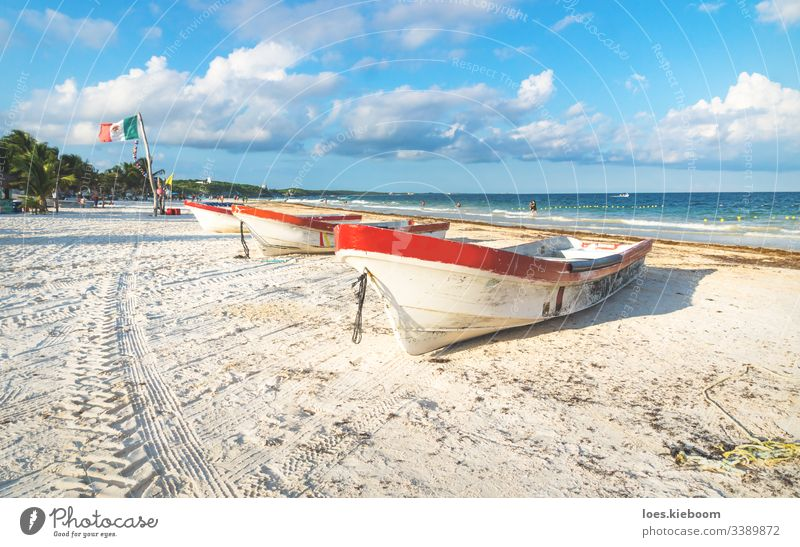 Boats on white sand at Playa Pescadores, Tulum, Mexico beach tulum mexico nature ocean sea playa pescadores summer tourism tropical water beautiful blue boat