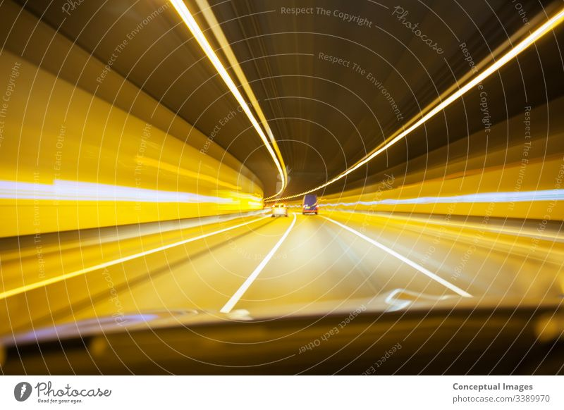 Car driving through tunnel road traffic night urban city highway transportation cityscape car speed travel motion dark fast evening modern movement busy