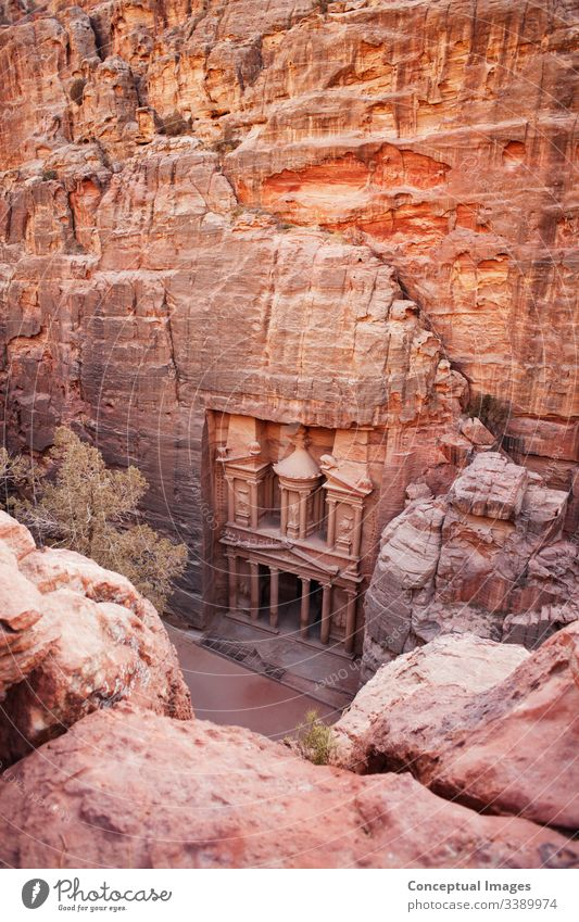 Elevated view of Al Khazneh - the treasury, ancient city of Petra,  Jordan.  Asia. adventure antique archaeology archeology architecture bedouin carved