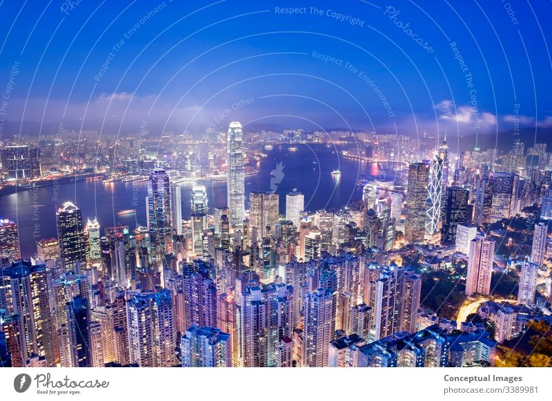 Hong Kong from Victoria peak at dusk, Hong Kong, China. Asia. architecture asia business china city cityscape downtown elevated view harbor hong hong kong