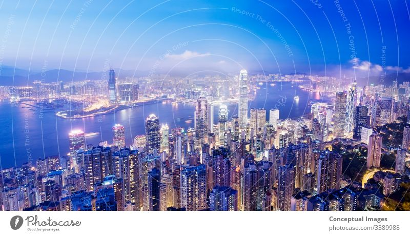 Panoramic image of Central Hong Kong and Victoria Harbour from Victoria peak at dusk Hong Kong, China. Asia. architecture asia business china city cityscape