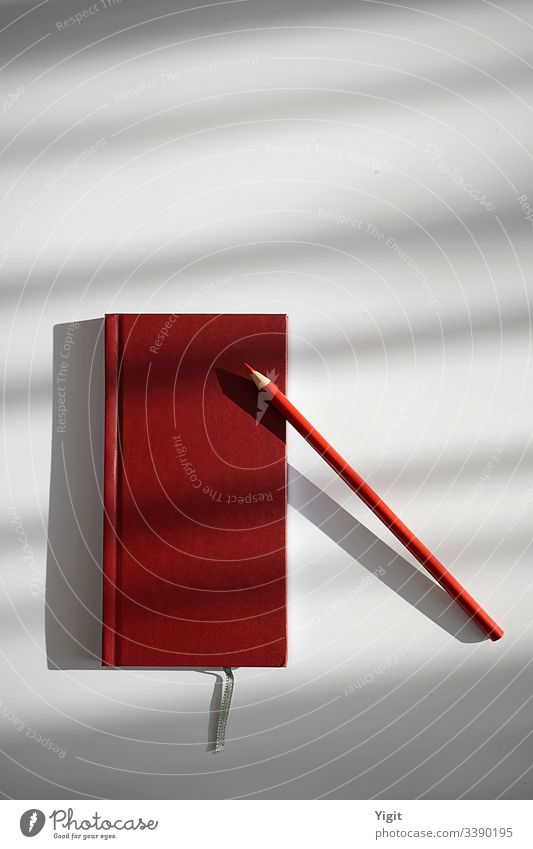 still life with red notebook and pencil a royalty free stock photo from photocase