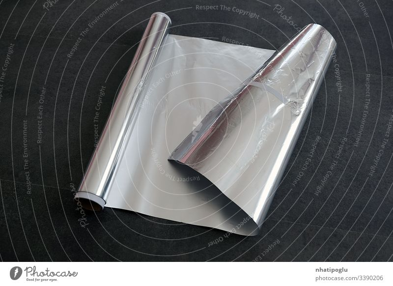 aluminum foil, rolled aluminum foil, close-up on a black background, paper isolated white bag blank packaging package plastic object food crumpled empty box