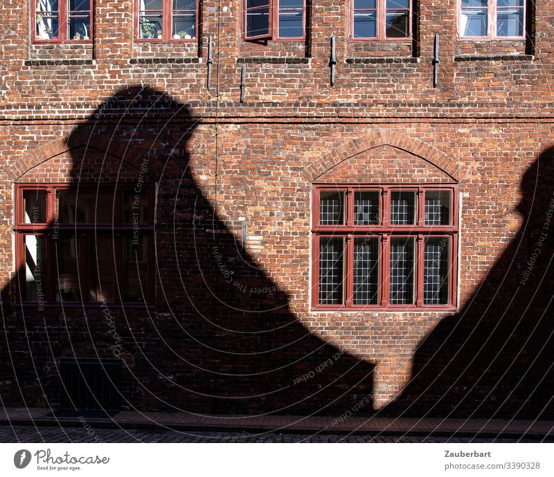 Red brick façade with window and shadow of a house opposite Facade Shadow Brick Window Wall (building) House (Residential Structure) Brick red