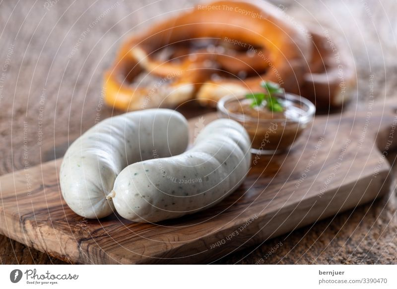 Pair of Bavarian veal sausages White sausages Veal sausage Breakfast plank Wood Portion Couple two Oktoberfest European Eating Hot Rustic Mustard Pretzel
