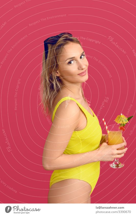 Attractive trendy blond woman with exotic cocktail Trendy attractive beverage body camera conceptual drink glass happy head her isolated leisure lifestyle